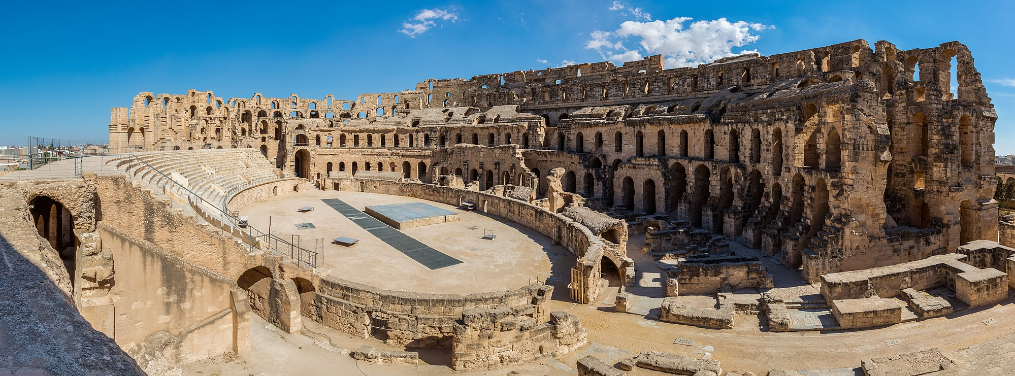 Panoramic view of the Amphitheatre of El Jem, an archeological site in the city of El Djem, Tunisia. Diego Delso CC BY-SA.