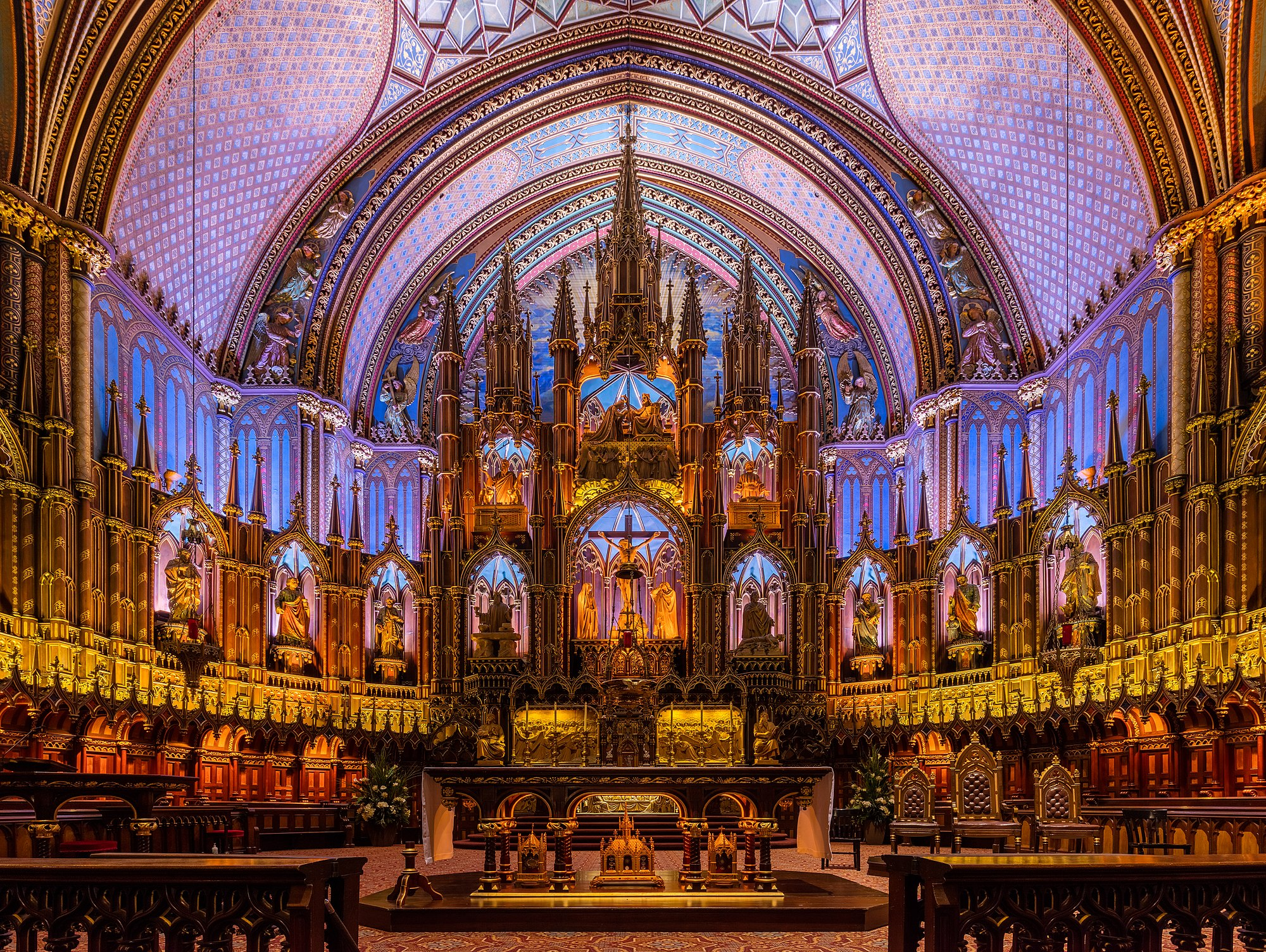 Interior of the Notre-Dame Basilica, located in the historic district of Old Montreal, in Montreal, Quebec, Canada. The interior of the basilica, built in Gothic Revival style, is impressive with vivid colors, stars and filled with hundreds of intricate wooden carvings and several religious statues. It was built between 1823 and 1829 after a design of James O'Donnell and it has become one of the landmarks of the city.