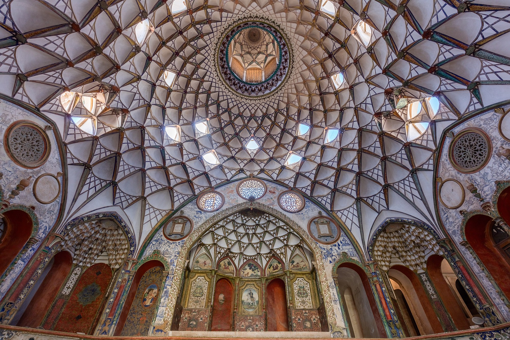View of the rich ceiling of the interior courtyard of the Borujerdi House, a historic house located in Kashan, Iran. The house dates from 1857 and was constructed by architect Ustad Ali Maryam for a wealthy merchant as proof of love to his wife.