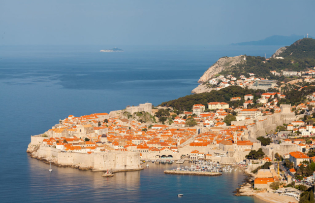 Early morning view of the Old Town of Dubrovnik and its city walls, an UNESCO Heritage Site since 1979. The former Republic of Ragusa was a maritime republic centered on the city of Dubrovnik (Ragusa in Italian and Latin) in Dalmatia (today in southernmost modern Croatia), that existed from 1358 (end of the sovereignty of Venice) to 1808 (conquered by Napoleon's French Empire). It reached its commercial peak in the 15th and the 16th centuries, under the protection of the Ottoman Empire. It had a population of about 30,000 people, of whom 5,000 lived within the city walls.