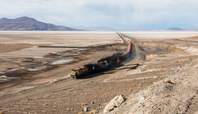 FCAB railway crossing the Carcote salt flat, northern Chile. The train covers the route Antofagasta – Calama – Ollagüe – Uyuni – La Paz, from 0 metres above level in the coastal city of Antofagasta to over 4,500 metres (14,800 ft) and has a total length of 1,537 km (955 mi). The locomotives have engines EMD GR12 2402, Clyde GL26C-2 2010 and Clyde GL26C-2 2005 whereas the Carcote salt flat has a surface of 108 square kilometers (42 sq mi).