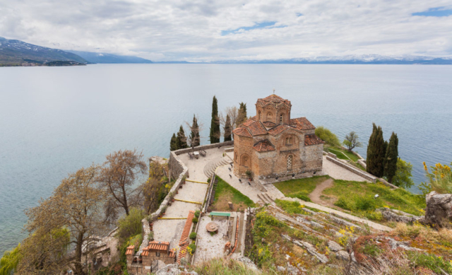 The Macedonian Orthodox church of Saint John at Kaneo, located on the cliff over the Kaneo Beach at the Ohrid Lake nearby the city of Ohrid, Northern Macedonia, is a pilgrimage iman in the country.