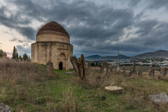 View of one of the Yeddi Gumbez Mausoleums at dusk in Şamaxı, Azerbaijan. The cemetery dates from 1810 and was built for a family of Mustafa khan – the last khan of Shamakhi.