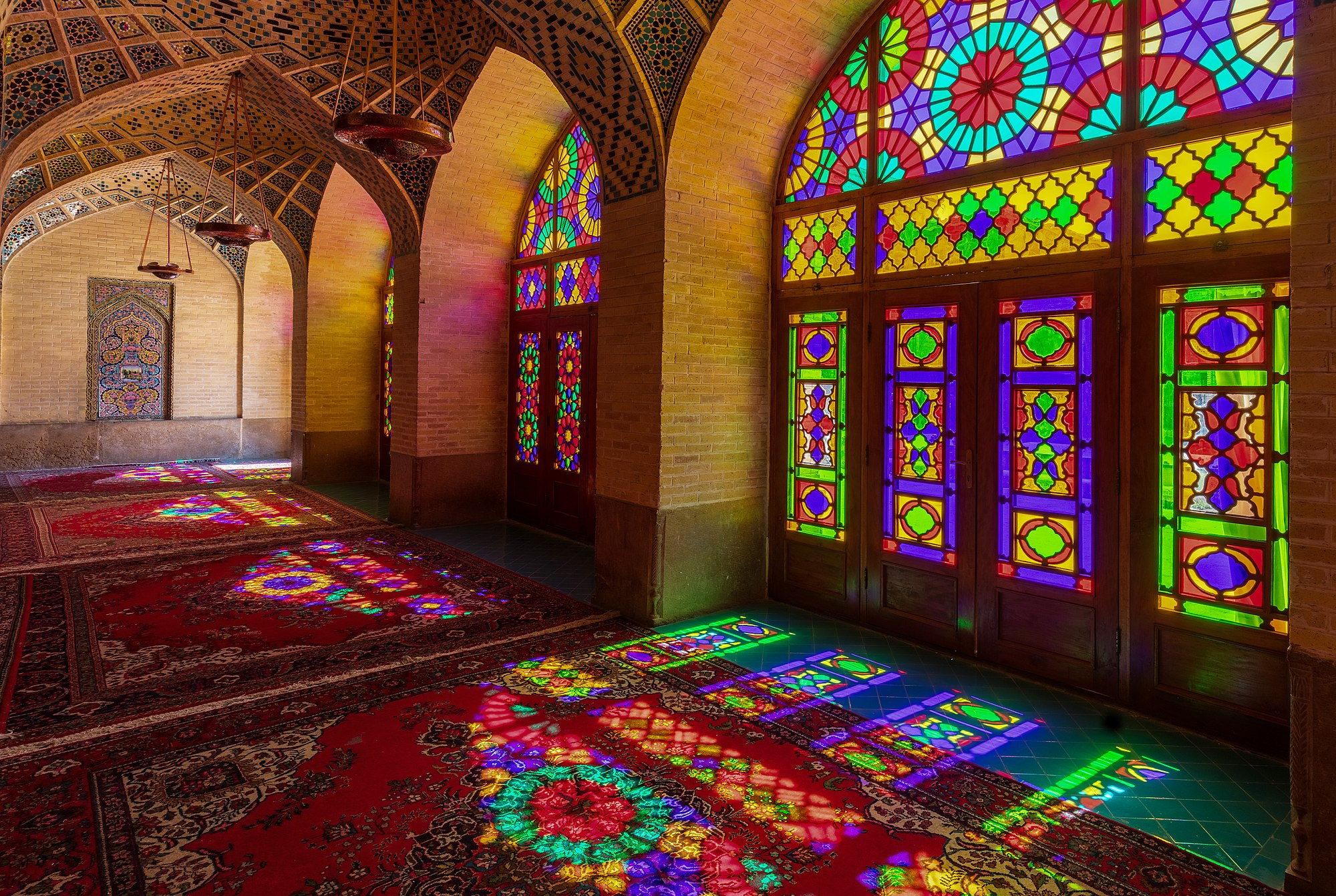 Colored windows seen from the interior of the Nasir-ol-Molk Mosque, also known as the Pink Mosque, a traditional mosque located in Shiraz district of Gouwd-e-Arabān, Iran. The mosque was built from 1876 to 1888, by the order of Mirzā Hasan Ali (Nasir ol Molk), a Qajar ruler.