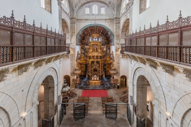 View of the main nave of the church of the monastery of San Martiño Pinario, Santiago de Compostela, Galicia, Spain. The temple, a work of Mateo López and González de Araújo, Bartolomé Fernández Lechuga and José de Peña y Toro, was finished in 1652. The jewel of the church is the elaborated reredos, the biggest designed by Fernando de Casas Novoa and of baroque style.