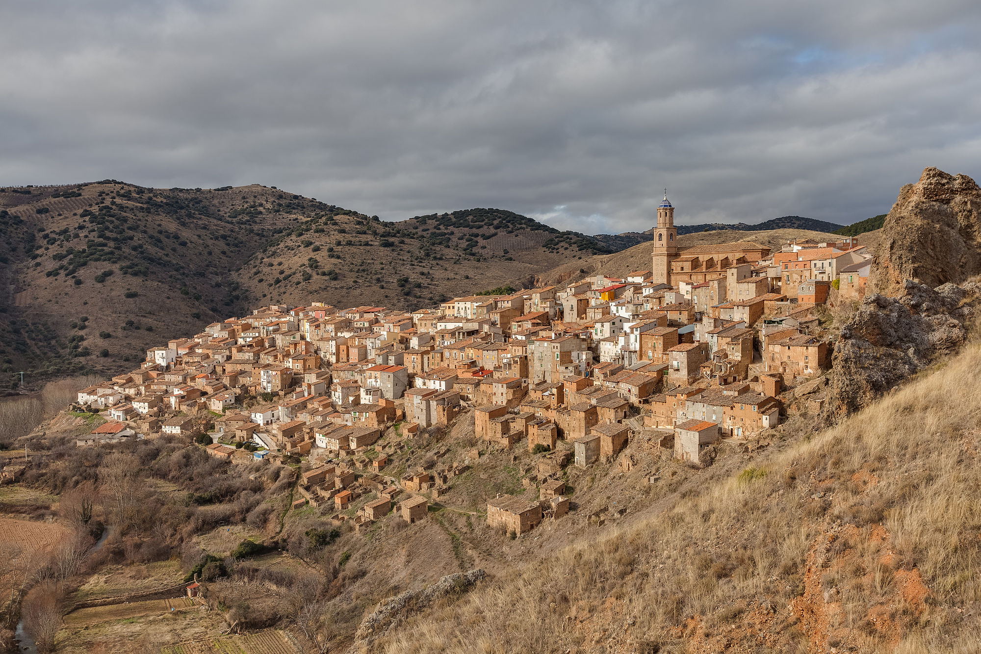 View of the small village of Moros, province of Zaragoza, Aragon, Spain. The whole village of Moros lies on a hill, with the most relevant buildings in the top (church and former town hall), the residences in the middle and the sheep pens at the bottom. The current population of Moros is 441 people (35% of the population one century ago, that's why many houses are abandoned).