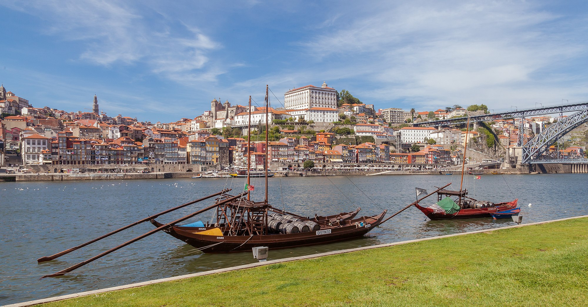 Rabelos in the Douro River with the city of Porto in the background, Portugal. Rabelos are traditional Portuguese wooden cargo boats used for centuries to transport people and goods from along the Douro River. Wine was brought in rabelos from the interior of the country to Porto, home to many wine cellars.
