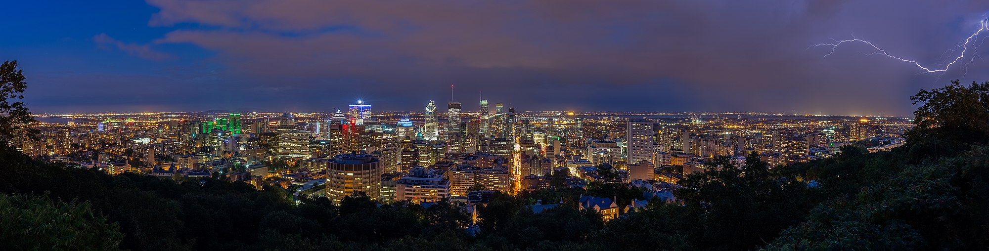Panoramic view of the city of Montreal in a stormy day from Mount Royal, Quebec, Canada.