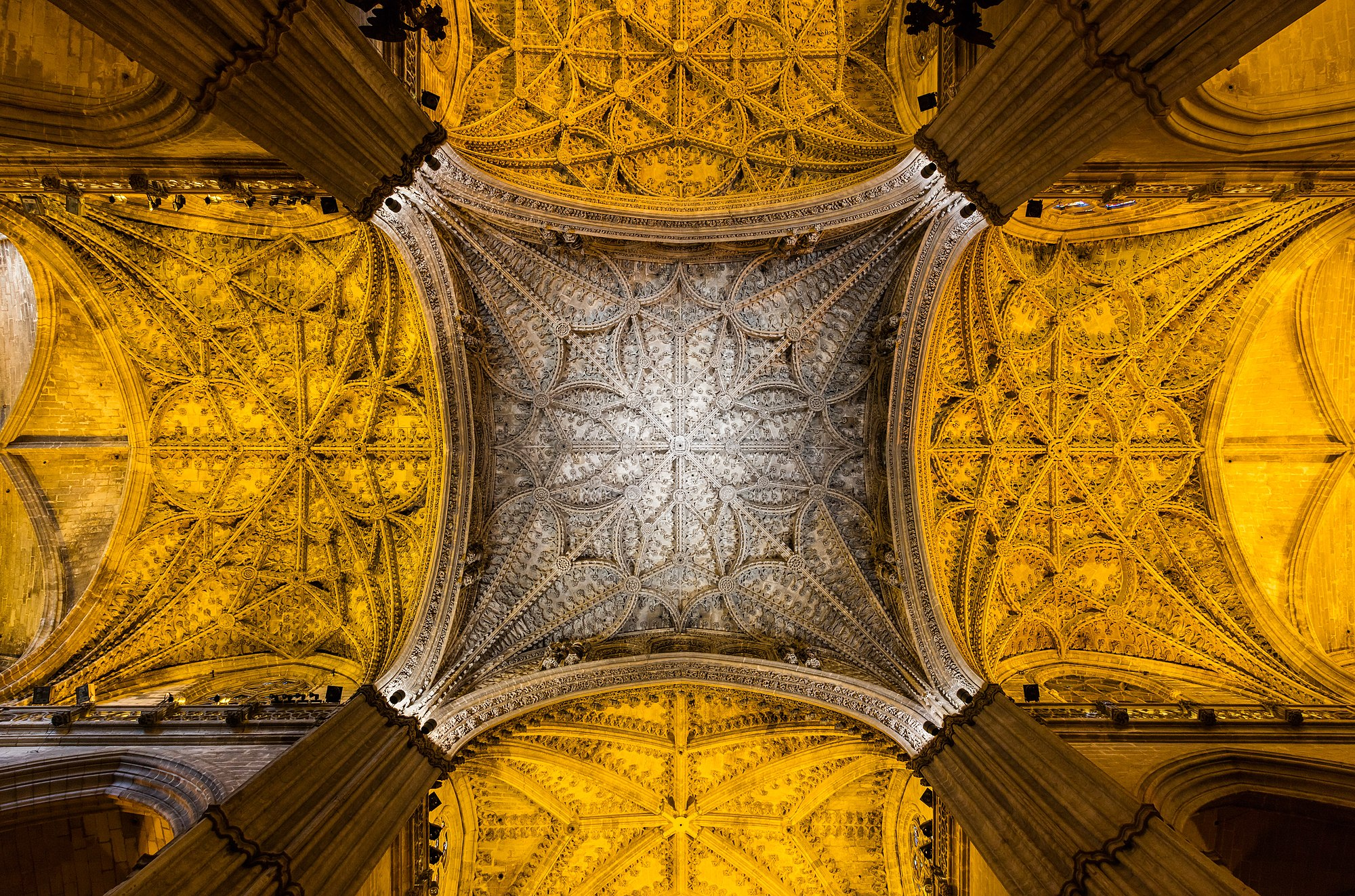 Bottom view of the crossing of the Roman Catholic cathedral of Seville, Seville, Spain. The temple is since 1987 a World Heritage Site according to the by UNESCO, is the largest Gothic cathedral and the third-largest church in the world. When it was completed, at the beginning of the 16th century, it became the successor of Hagia Sophia as the largest cathedral in the world, a title the Byzantine church had held for nearly a thousand years. The cathedral is also the burial site of Christopher Columbus.