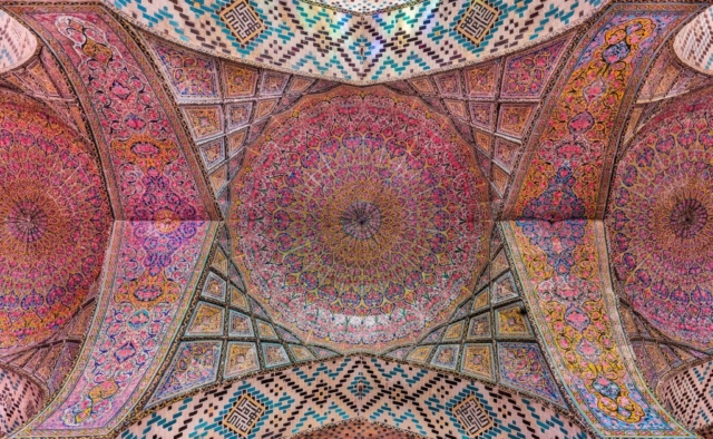 View of the ceiling in the interior of the Nasir-ol-Molk Mosque, also known as the Pink Mosque, is a traditional mosque located in Shiraz district of Gowad-e-Arabān, Iran. The mosque was built from 1876 to 1888, by the order of Mirzā Hasan Ali (Nasir ol Molk), a Qajar ruler.