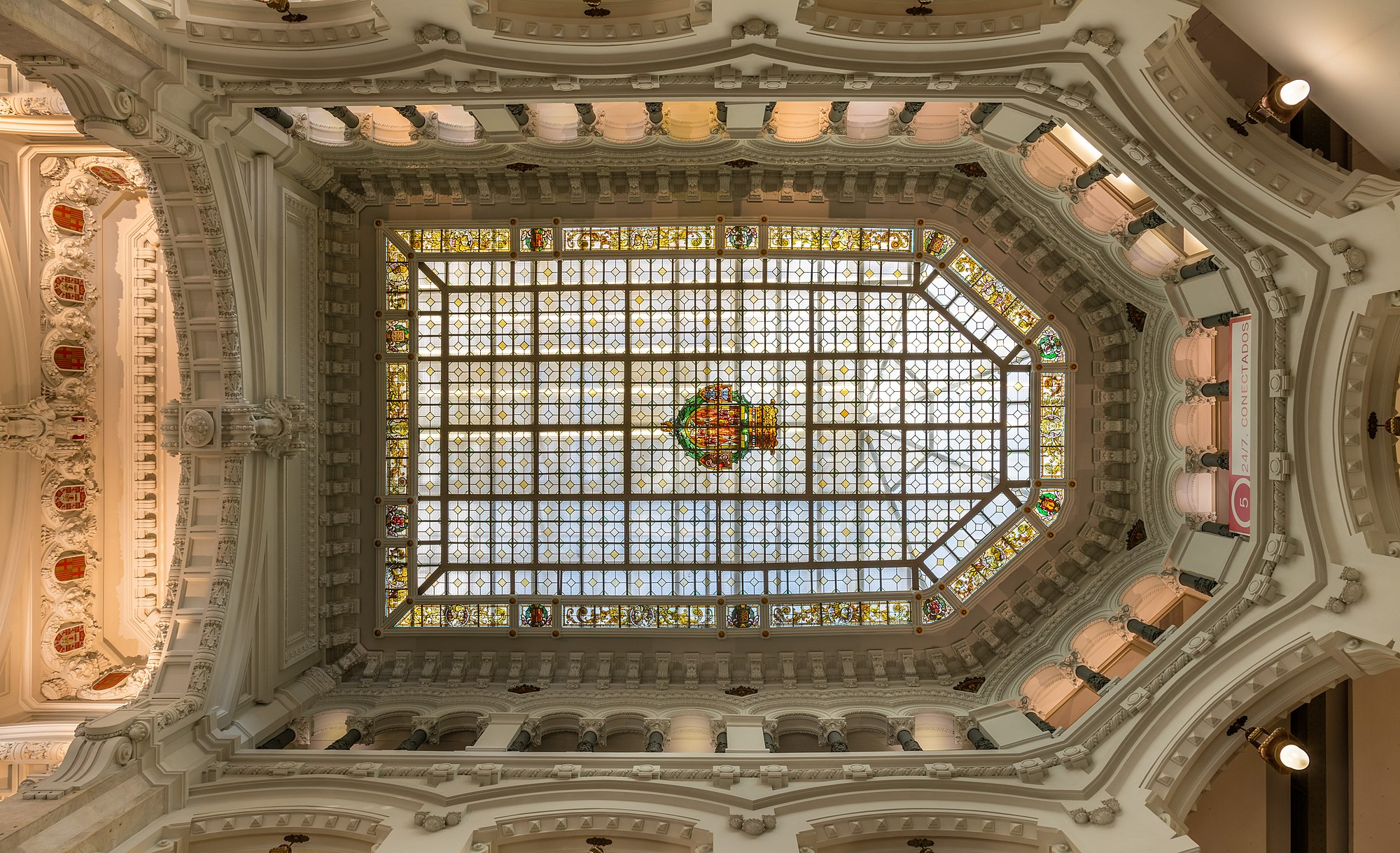 Skylight in the Cybele Palace or Palace of Communication, located on the Plaza de Cibeles, Madrid, Spain. The building, one of the landmarks of Spain's capital, was inaugurated in 1919 as headquarters of the Spanish postal and telecommunications service (Correos). The building was designed by Antonio Palacios and Joaquín Otamendi. Today the building is seat of the City Council.