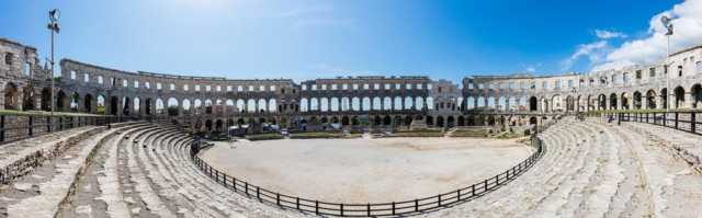 Panoramic view of the interior of the Pula Arena, an amphitheater located in Pula, Croatia.