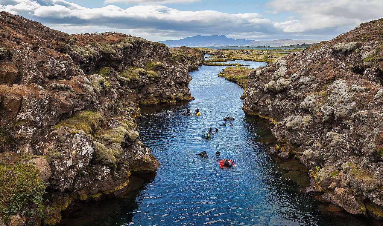 Snorkeling in the Silfra canyon, a rift between the tectonic plates (North American and Eurasian), Þingvellir National Park, Iceland.