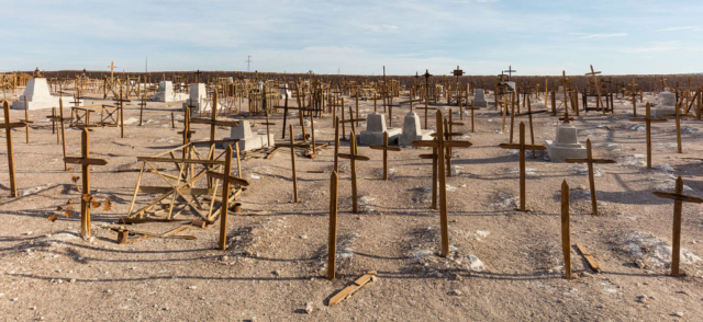 Wooden crosses in the cemetery of the former salt mining Rica Aventura, María Elena, northern Chile.