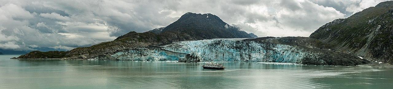 Safari Endeavour vessel (232 feet/71 m) long in front of the Lamplugh Glacier, Glacier Bay National Park, Alaska, United States.