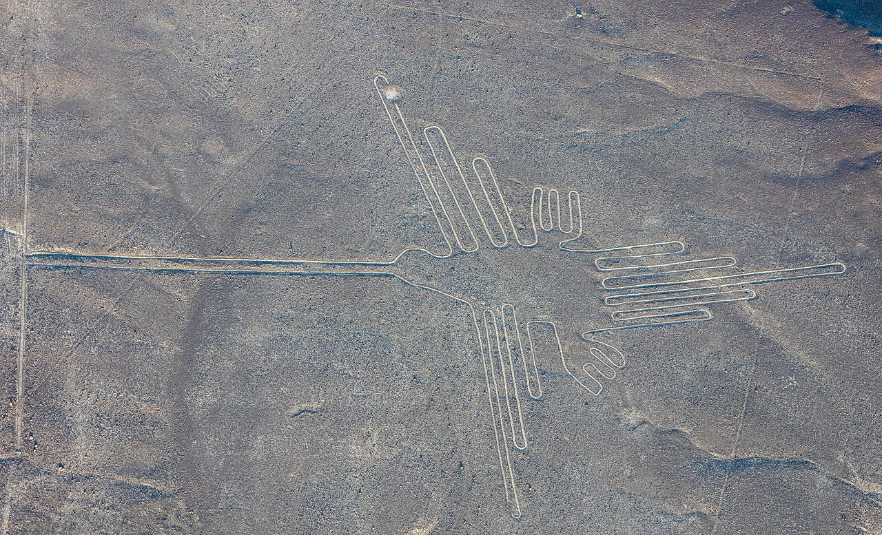 "Aerial view of ""The Hummingbird"", one of the most popular geoglyphs of the Nazca Lines, which are located in the Nazca Desert in southern Peru. The geoglyphs of this UNESCO World Heritage Site (since 1994) are spread over a 80 km (50 mi) plateau between the towns of Nazca and Palpa and are, according to some studies, between 500 B.C. and 500 A.D. old."