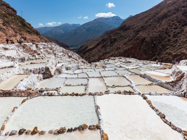 Salineras (salt evaporation ponds) in Maras, Peru. Salt has been harvested in Maras since the time of the Inca Empire. The site has around 3000 ponds of 5 square metres (54 sq ft) each. As the location is surrounded by salty mountains, subterrean water deposits the salty water in the ponds; the water evaporates due to the exposure to the sun. After approx. 1 month the level of salt reaches 10 centimetres (3.9 in) and is removed in sacks.