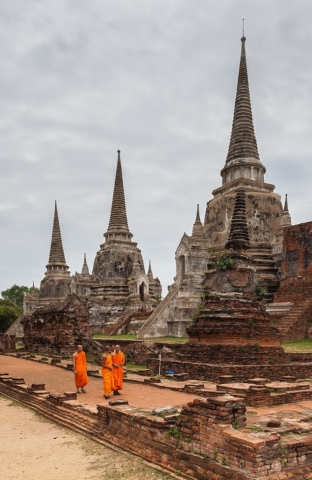 Buddhist monks walking around Phra Si Sanphet temple, Ayutthaya, Thailand